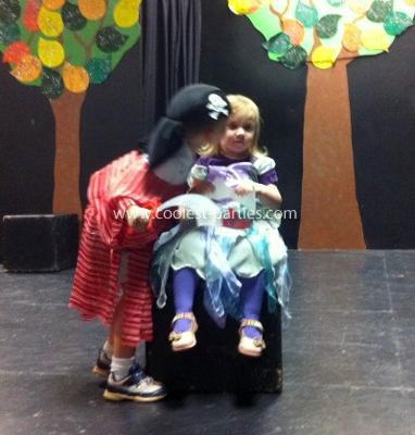 Pirate Luke, the birthday boy, kissing his sister, the little mermaid